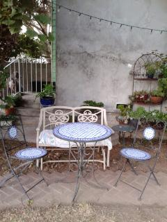 Enjoy Outdoor Dining on the Mosaic Bistro Table under Tall Shady Trees overlooking tranquil garden