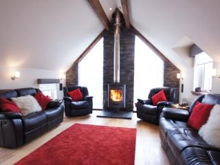 Upstairs lounge with open fire and reclining seats and sofas