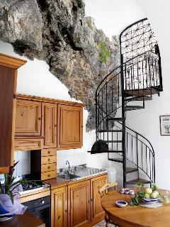 Kitchen and spiral staircase to the terrace
