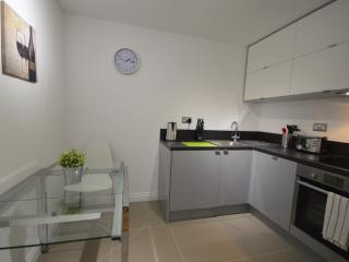 Kitchen with dishwasher, washer/dryer and table with 4 chairs