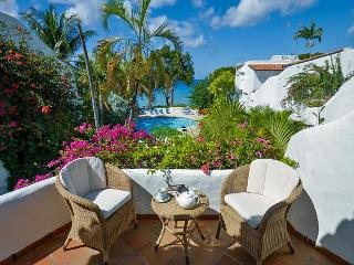 Delightful Mediterranean-style beachfront villa is set within the popular Ian Morrison designed Merlin Bay community and enjoys lovely views, The Garden
