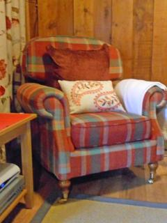 Cosy checks and calico florals complement the cedar walls