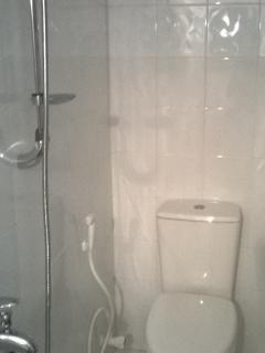 fully tiled bath room