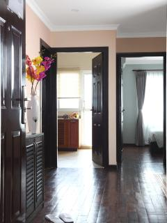 View of kitchen and bedroom from entry door, Deluxe Apartments