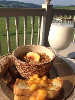 stuffed french toast topped with peaches and served with baked oatmeal