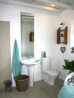Large bathroom with shower and corner bath