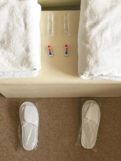 Fresh Towels and Spa Slippers