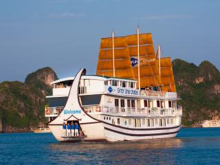 Gray Line Halong cruise among thousand islets of Halong bay - landing dragon, a legend.