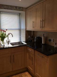 Kitchen sink and black granite tops