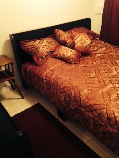 bedroom one   queen bed