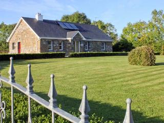 GRANGE LODGE, detached cottage on the banks of Grange Lough, all ground floor