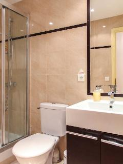 Enjoy your own power shower and elegant marble feature bathroom.