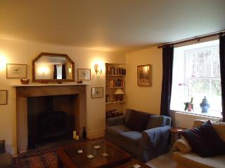 The large sitting room has a wood burner and patio out to the garden.