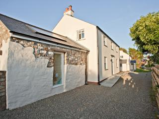 Panteg Farmhouse Cottage-in the distance nestled down a quiet lane next door to Boathouse Cottage