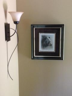 Bear-themed print in stairway