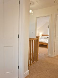 Oak stair case and warm carpets upstairs, oak and slate floors downstairs - just beautiful!