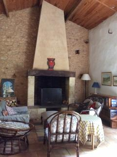 The sitting room with open fireplace