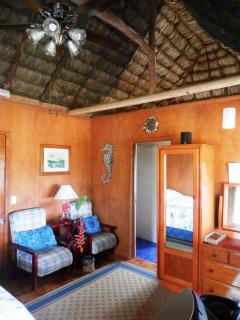 High Naturally Thatched Roof and large ceiling fan all keep it cool as the ocean breeze