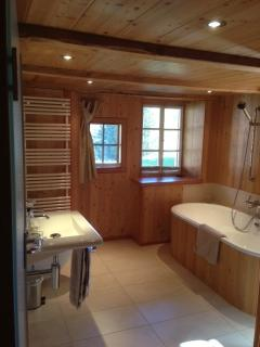 Main bathroom with mountain views from the tub!