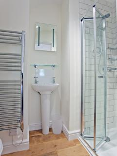 En-suite shower-room to the bedroom with king-size bed
