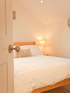 A peek into the double bedroom that also has an en-suite shower-room