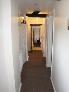 Corridor in kingfisher cottage leading to bedrooms