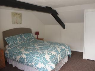 King size bed in the double room in lodge cottage