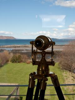 A replica brass telescope from the early 20th Century lets you watch the creelers out in the bay.