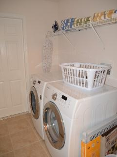 laundry room. New washer and dryer