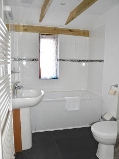 Family bathroom, downstairs has bath, shower enclosure, toilet and basin.