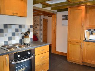 Well equipped oak kitchen which follows through to the dining area below