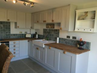 well equipped kitchen with dishwasher and washer/dryer