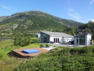 Summer house close by the sea, in the midnight sun, Narvik