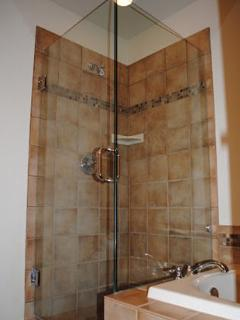 Master Bathroom Shower with Frameless Enclosure and Mosaic Slate Tiles