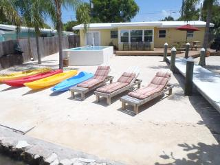 Beach sand backyard and 100 foot deep water dock.