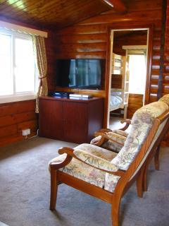 Living room leading to two bedrooms and bathroom