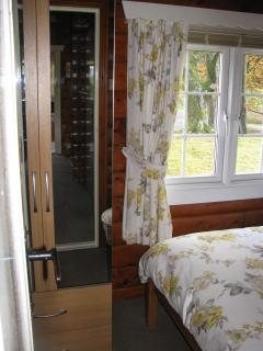 Main bedroom with personal television,DVD player and wardrobe