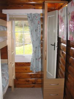 Second bedroom with wardrobe and mountain views
