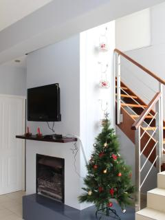 Fireplace and TV and stairway to 2nd floor to bedrooms
