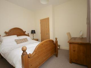 Bedroom with double bed, hairdryer, TV