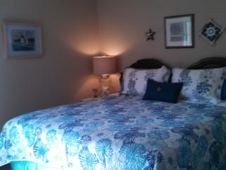 King Bed, HD TV on opposite wall, reading lamps.  Color TV in bedroom opposite wall