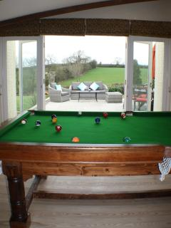 Or maybe the optional snooker / pool table overlooking BBQ area and 3 acre gardens