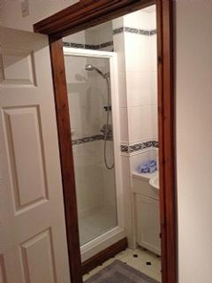 En suite shower room to bedroom 1.