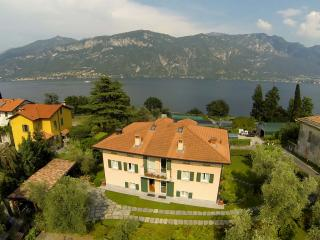 Front of property, mountain and lake view