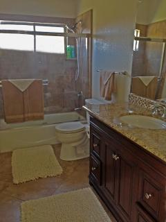 Master bathroom upstairs with tub/shower