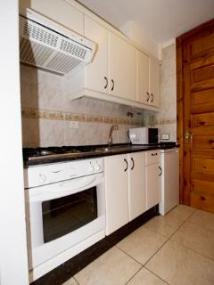 fully equipped kitchen including microwave & oven