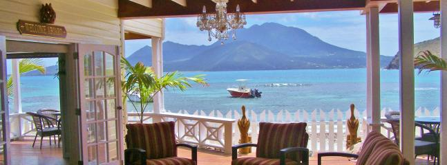 Ocean Song private beach front lounge with honor bar, beach chairs, snorkel equipment, games.