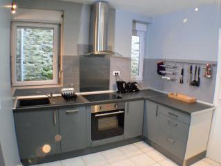 Modern kitchen with glass hob, fan oven, Tassimo coffee maker, large fridge