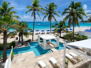 ALABASTER...  A luxurious beachfront 3 BR villa in Coral Beach Club on Dawn Beach, Oyster Pond