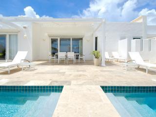 ALABASTER...  A luxurious beachfront 3 BR villa in Coral Beach Club on Dawn